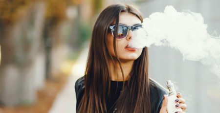 Girl vaping CBD